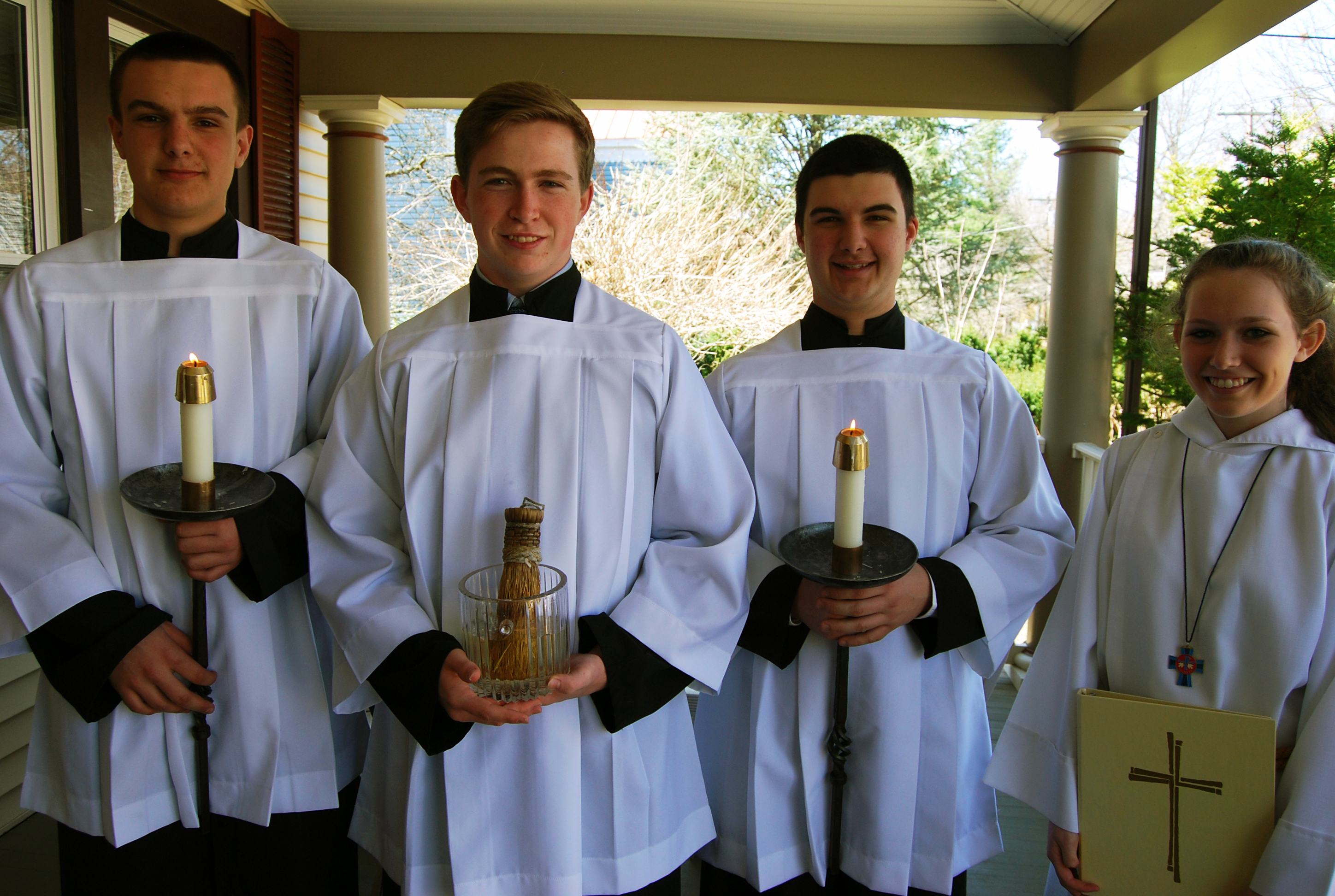 altar-servers-on-porch-of-parish-center