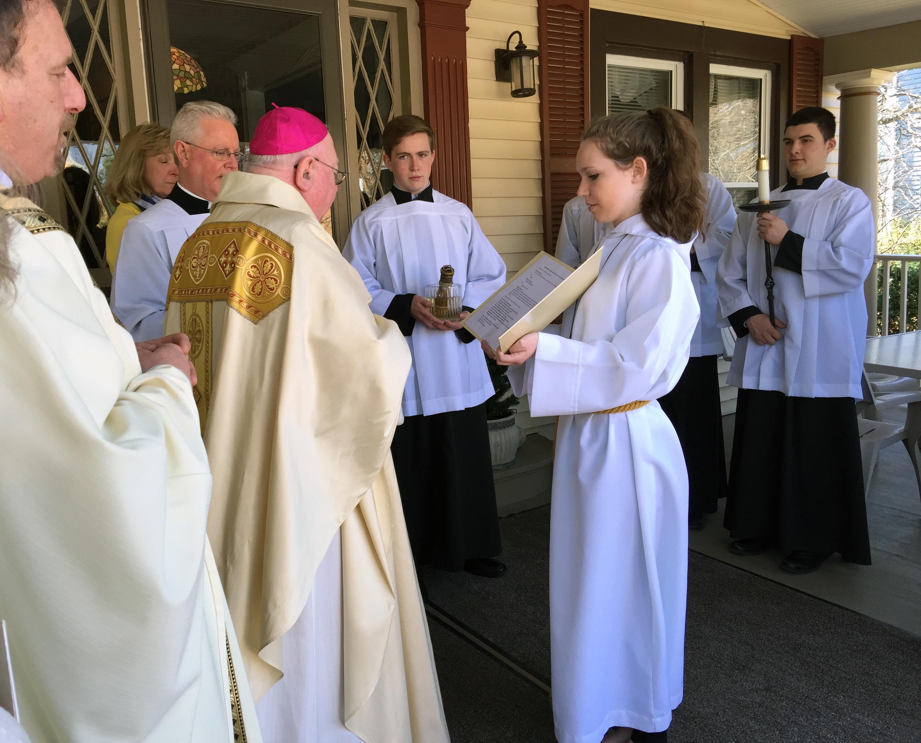 bishop-murphy-dedicating-parish-center-on-porch