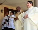 priests-servers-and-decon-on-porch-of-parish-center